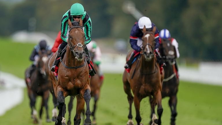 James Doyle riding Century Dream (green) wins The Ladbrokes Celebration Mile Stakes at Goodwood Racecourse.