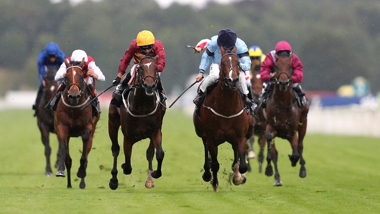 Gear Up ridden by jockey Silvestre De Sousa (centre left yellow helmet) on the way to winning the Tattersalls Acomb Stakes during day one of the Yorkshire Ebor Festival at York Racecourse.