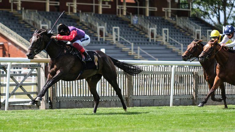Lightness ridden by jockey Frankie Dettori (left) winning at Newmarket