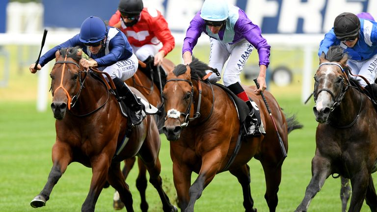 Mohawk King ridden by jockey Pat Dobbs (left) on their way to win the Anders Foundation British EBF Crocker Bulteel Maiden Stakes at Ascot Racecourse.