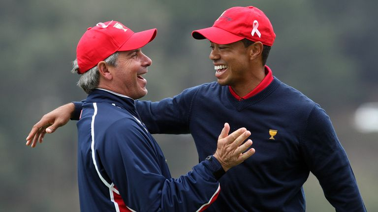 Fred Couples congratulates Woods on his victory in the singles