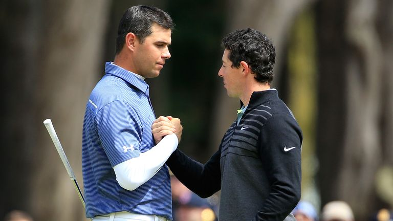 Gary Woodland congratulates McIlroy after losing out in the final