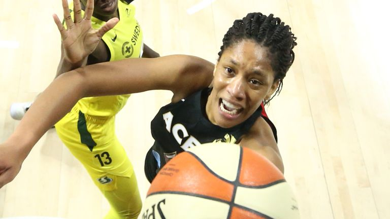 A'ja Wilson reaches for the basket