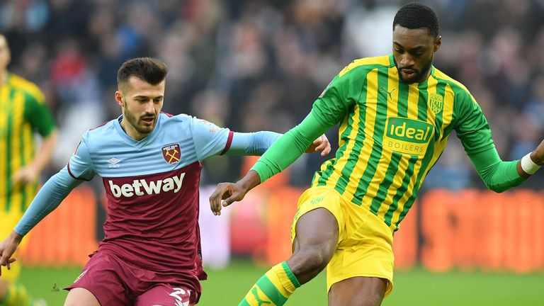 West Ham striker Albian Ajeti (L) and West Bromwich Albion defender Semi Ajayi in action in their FA Cup tie at the London Stadium