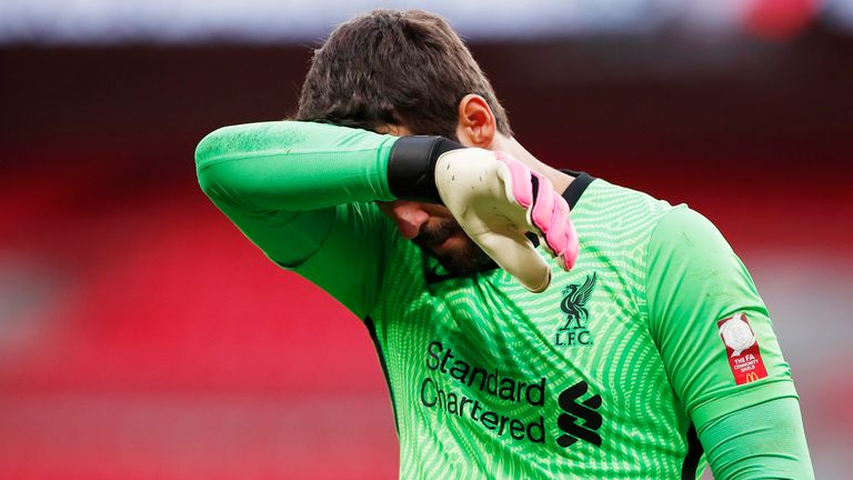Alisson was unable to get close to any of Arsenal's five converted penalties