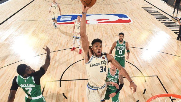 Giannis Antetokounmpo of the Milwaukee Bucks drives to the basket during the game against the Boston Celtics