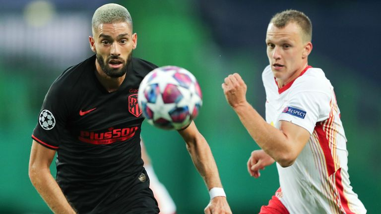 Atletico Madrid's Yannick Carrasco vies with RB Leipzig's  Lukas Klostermann