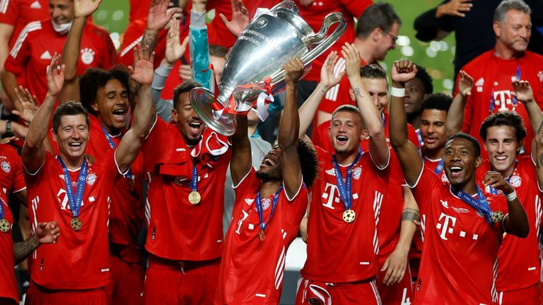 Match-winner Kingsley Coman lifts the Champions League trophy