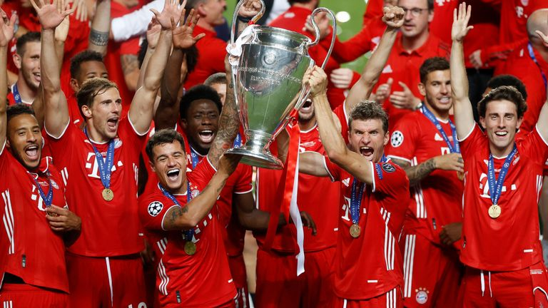 Bayern Munich players celebrate with the trophy
