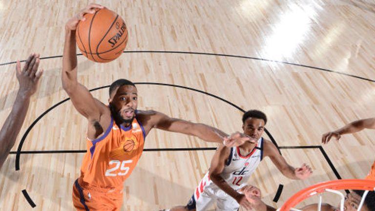 Mikal Bridges of the Phoenix Suns drives to the basket against the Washington Wizards