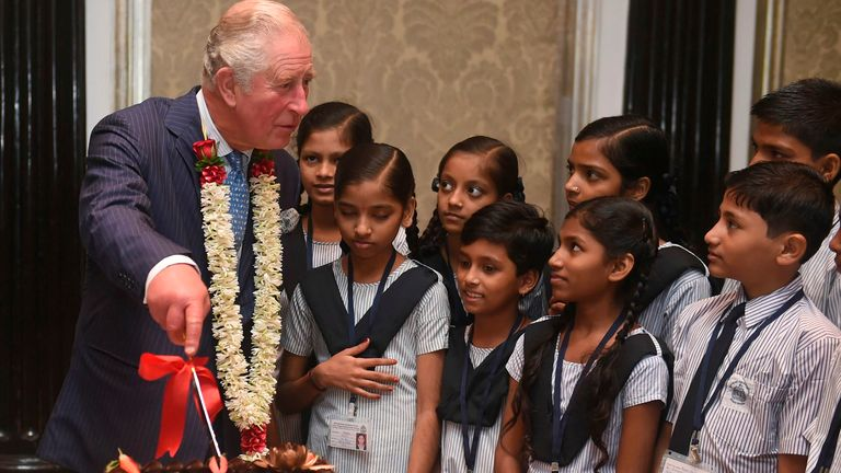 Britain's Prince Charles interacts with children from the Kaivalya Education Foundation supported by the British Asian trust, in Mumbai in 2019