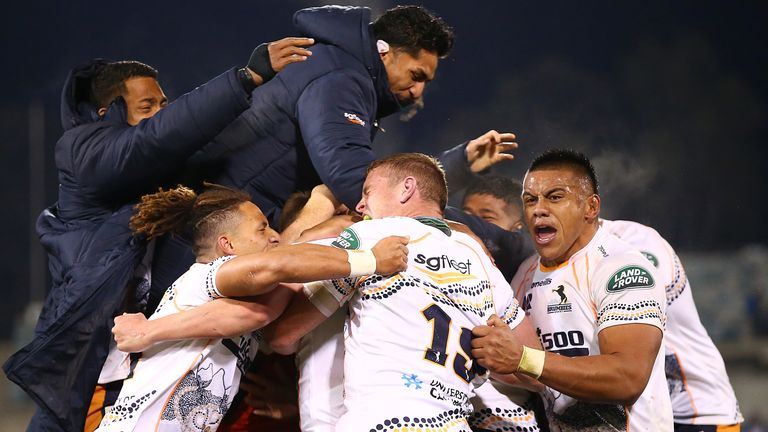 The Brumbies celebrate their last-gasp victory over the Reds