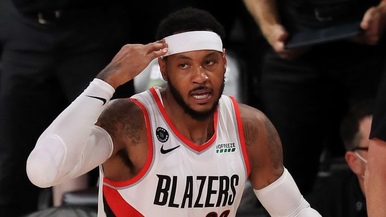 Carmelo Anthony celebrates a three-pointer in Portland's overtime win over Memphis