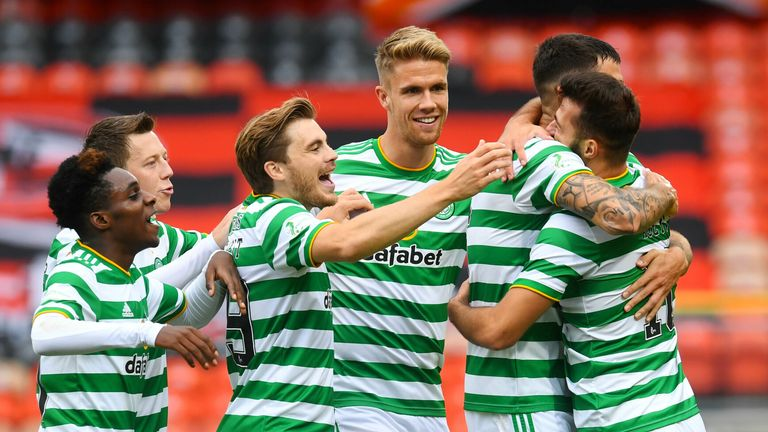 DUNDEE, SCOTLAND - AUGUST 22: Celtic's Albian Ajeti celebrates with teammates after scoring to make it 1-0 during  the Scottish Premiership match between Dundee Utd  and Celtic at Tannadice,  on August 22, 2020, in Dundee, Scotland. (Photo by Craig Foy / SNS Group)