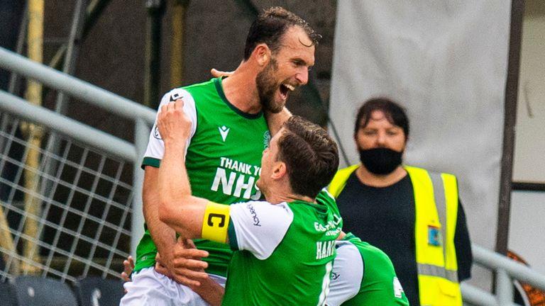 Christian Doidge celebrates after scoring for Hibernian against  Dundee United