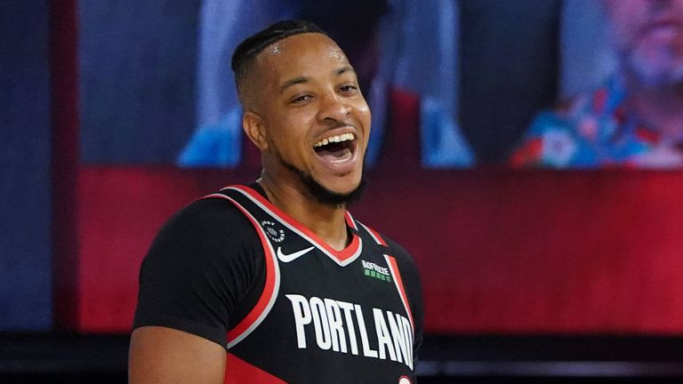CJ McCollum of the Portland Trail Blazers laughs on the court