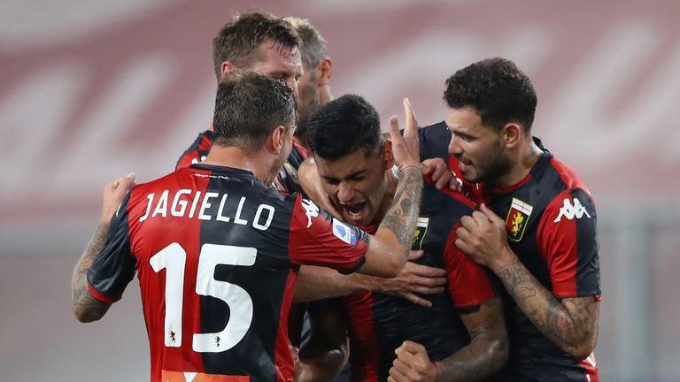 Cristian Romero celebrates extending Genoa's lead over Verona