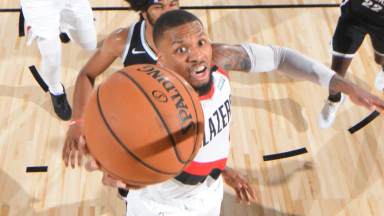 Damian Lillard rises to the rim against the Brooklyn Nets