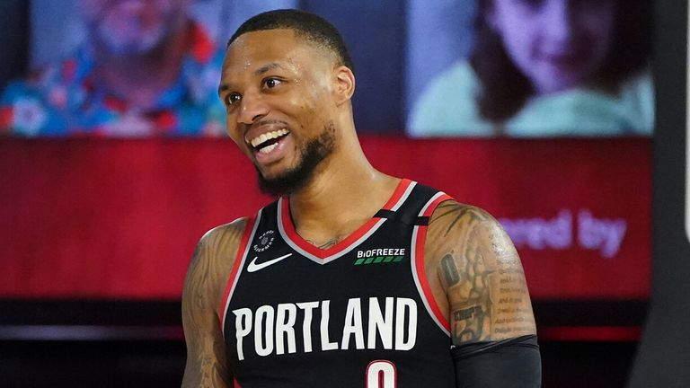 Damian Lillard celebrates after Portland's victory in the Western Conference Play-In