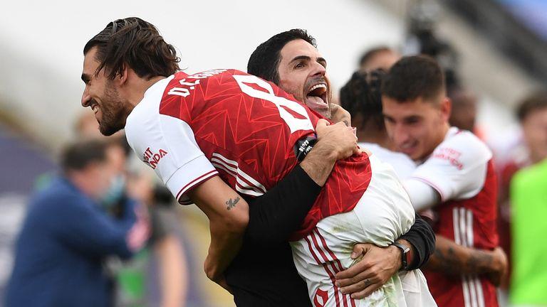 Dani Ceballos and Mikel Arteta celebrate winning the FA Cup