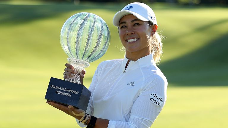 Danielle Kang poses with the trophy after winning the LPGA Drive On Championship