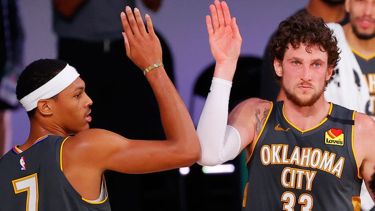 Darius Bazely and Mike Muscala high-five after the Thunder's win over the Heat