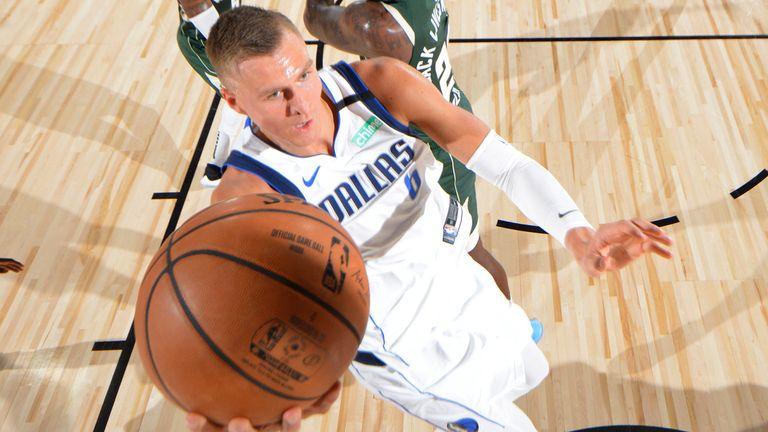 Kristaps Porzingis scores at the rim against the Milwaukee Bucks