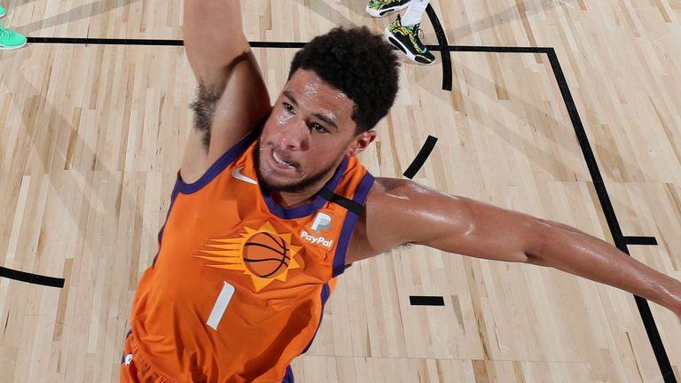 Devin Booker throws down a dunk against the Mavericks