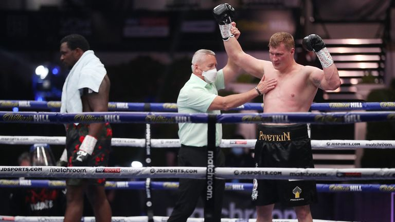 HANDOUT PICTURE COMPLIMENTS OF MATCHROOM BOXING.Dillian Whyte  vs Alexander Povetkin, WBC Diamond Belt Title fight..22 August 2020.Picture By Mark Robinson..Dillian Whyte looks dejected as Alexander Povetkin...s am is raised.
