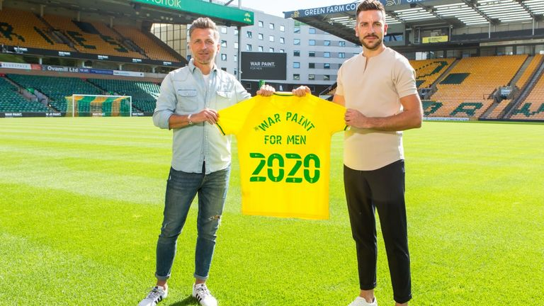 Eadie and War Paint founder Danny Gray announce the partnership on the Carrow Road pitch