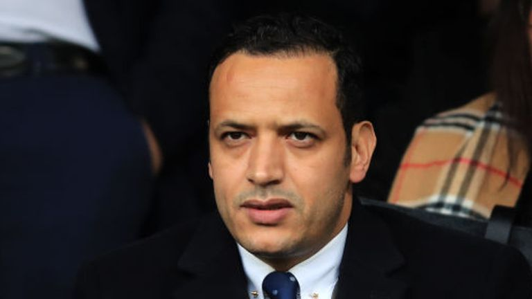 An arbitrator has ruled Oldham chairman Abdallah Lemsagam did not breach the terms of the manager's contract.