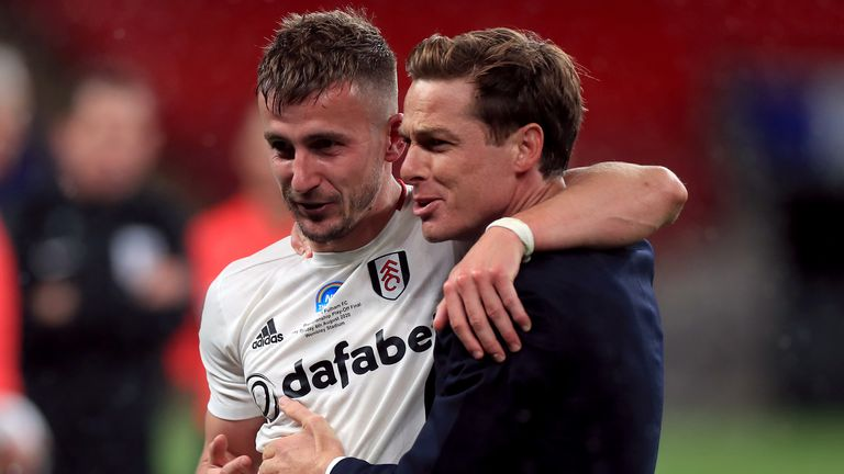 "Fulham manager Scott Parker celebrates with goalscorer Joe Bryan after winning the Sky Bet Championship Play Off Final at Wembley Stadium, London. PA Photo. Issue date: Tuesday August 4, 2020. See PA story SOCCER Championship. Photo credit should read: Mike Egerton/PA Wire...EDITORIAL USE ONLY No use with unauthorised audio, video, data, fixture lists, club/league logos or ""live"" services. Online in-match use limited to 120 images, no video emulation. No use in betting, games or single club/league/player publications."