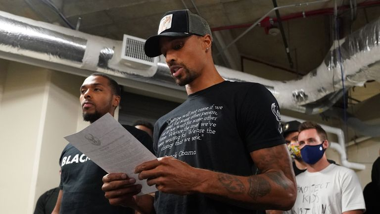 Milwaukee Bucks guard George Hill reads a statement following the players' decision to boycott their playoff game against the Orlando Magic