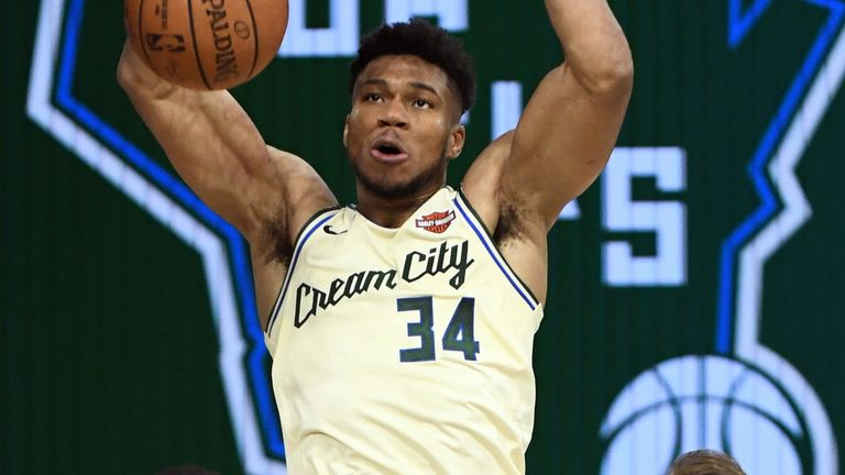 Giannis Antetokounmpo slams home a dunk en route to 36 points against Boston