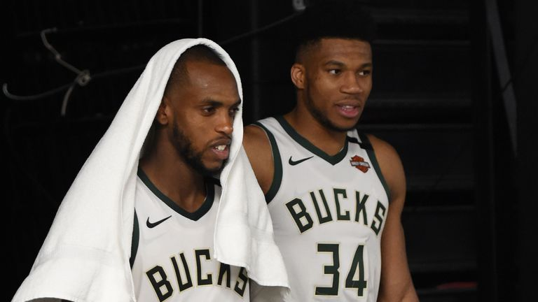 Khris Middleton and Giannis Antetokounmpo leave the playing arena after the Milwaukee Bucks beat the Orlando Magic in Game 5 of their first-round playoff series