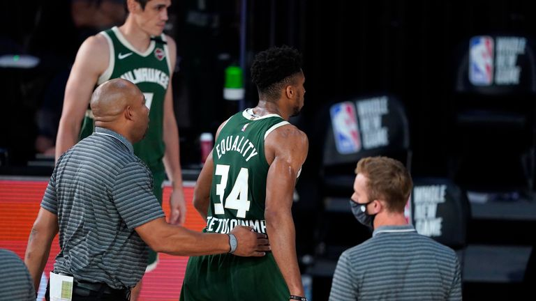 Giannis Antetokounmpo leaves the court after being ejected for head-butting Moritz Wagner.
