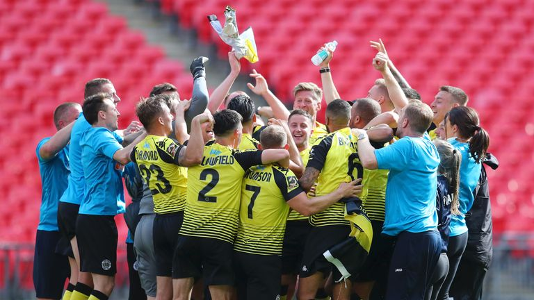 Harrogate Town players and staff celebrate after beating Notts County 3-1 in the National League play-off final at Wembley.