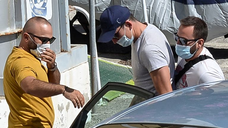 Harry Maguire, in the blue cap, at a police station on Syros (Pic: Athena Pictures)