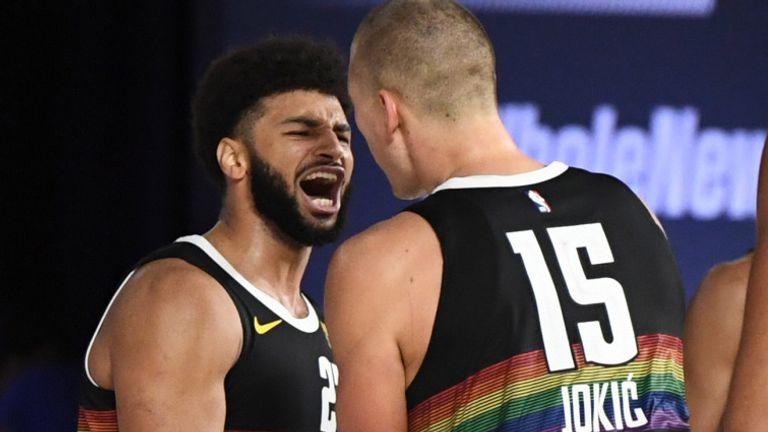 Jamal Murray celebrates with Denver Nuggets team-mate Nikola Jokic