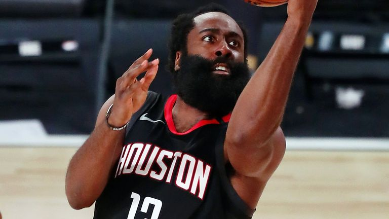 James Harden lofts a scoop shot during the Rockets' win over the Lakers