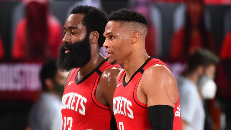 James Harden and Russell Westbrook walk off the court together