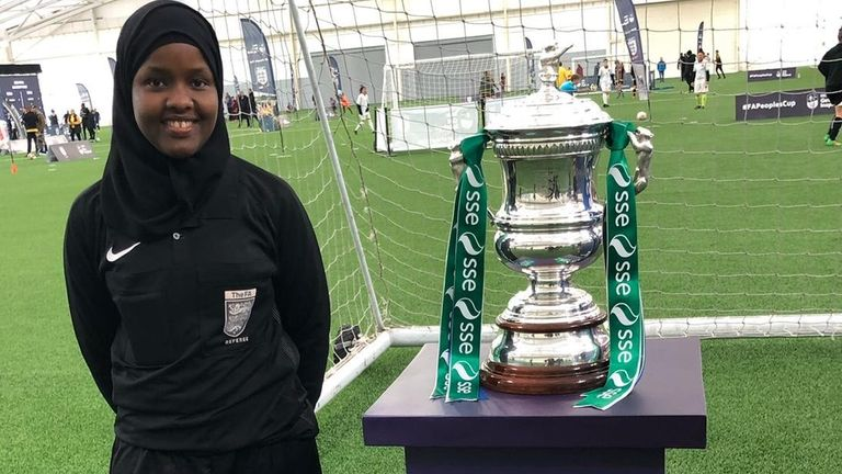 Roble pictured with the Women's FA Cup trophy (Credit: Jawahir Roble)
