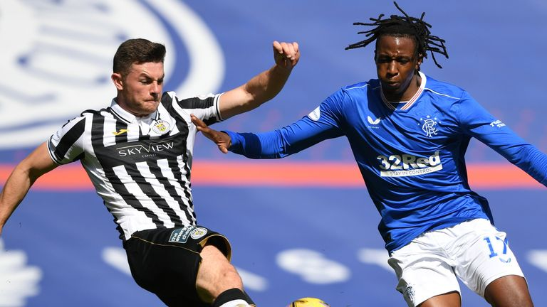 Nathan Sheron challenges Joe Aribo during the Scottish Premiership match