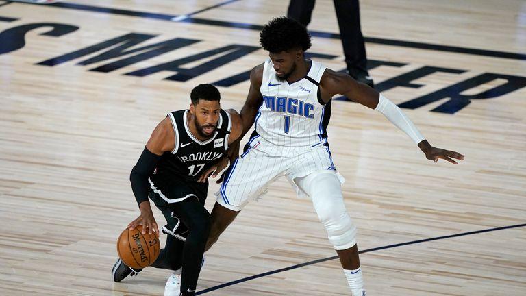 Brooklyn Nets' Garrett Temple (17) dribbles as Orlando Magic's Jonathan Isaac (1) defends