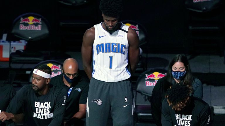 Orlando Magic's Jonathan Isaac stands before the start of an NBA basketball game between the Brooklyn Nets and the Magic
