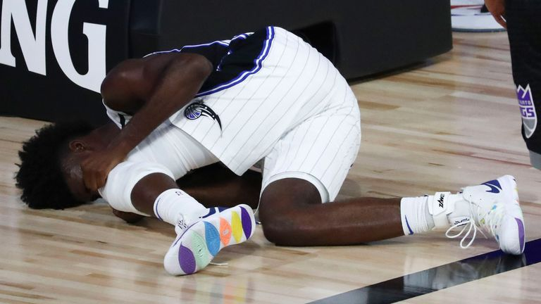 Jonathan Isaac suffers a knee injury during the Magic's win over the Kings