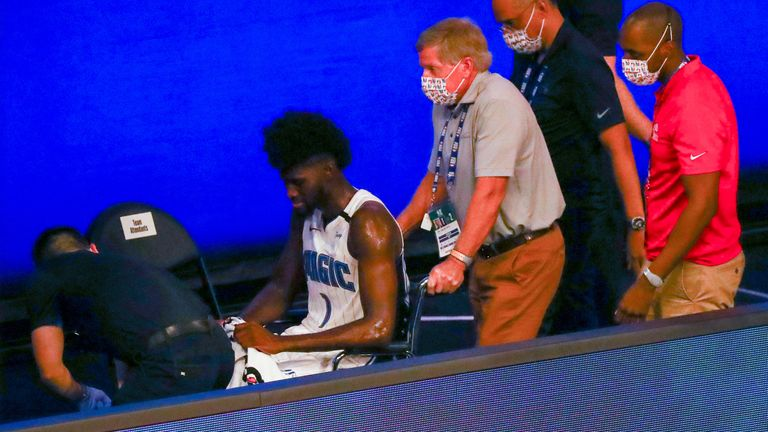 Jonathan Isaac is wheeled to the locker room after suffering a knee injury against the Kings