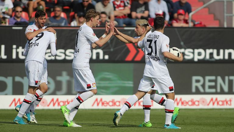Kai Havertz is congratulated during the Bundesliga match between FC Ingolstadt 04 and Bayer 04 Leverkusen at Audi Sportpark on May 6, 2017 in Ingolstadt, Germany.