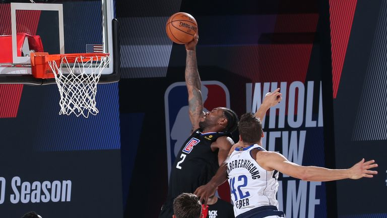 Kawhi Leonard of the LA Clippers dunks the ball against the Dallas Mavericks during Round One, Game Six of the NBA Playoffs