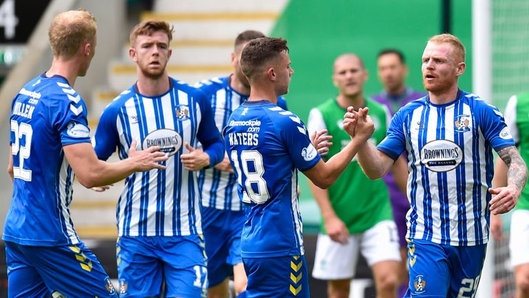 Kilmarnock's Chris Burke is congratulated by his team-mates after pulling a goal back against Hibernian
